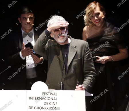Stock Photo of Pedro Costa (C) attends the closing gala of the 57th edition of the Gijon International Film Festival, in Gijon, Asturias, northern Spain, 23 November 2019. The film 'Vitalina Varela' by Pedro Costa received the Best Film and Best Photography Director awards. Others are not identified.