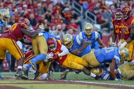 USC Trojans running back Stephen Carr (7) scores a touchdown during the UCLA Bruins vs USC Trojans football game at United Airlines Field at the Los Angeles Memorial Coliseum on (Photo by Jevone Moore)