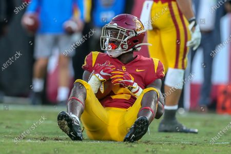 USC Trojans cornerback Greg Johnson (9) just misses a interceptions during the UCLA Bruins vs USC Trojans football game at United Airlines Field at the Los Angeles Memorial Coliseum on (Photo by Jevone Moore)