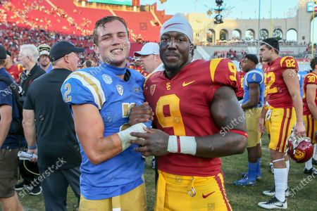 UCLA Bruins wide receiver Kyle Philips (2) and USC Trojans cornerback Greg Johnson (9) after the UCLA Bruins vs USC Trojans football game at United Airlines Field at the Los Angeles Memorial Coliseum on (Photo by Jevone Moore)