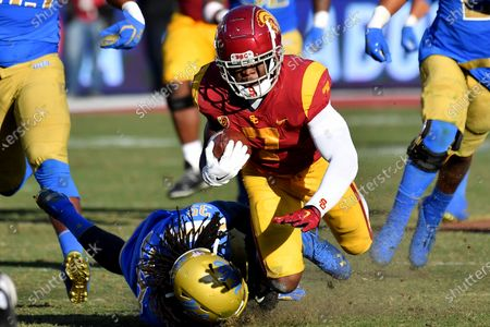 Los Angeles, CA.USC Trojans running back Stephen Carr #7 runs in action tackled by UCLA Bruins linebacker Carl Jones #35 during the third quarter of the NCAA Football game between the USC Trojans and the UCLA Bruins at the Coliseum in Los Angeles, California..The USC Trojans defeat the UCLA Bruins 52-35.Mandatory Photo Credit : Louis Lopez/CSM