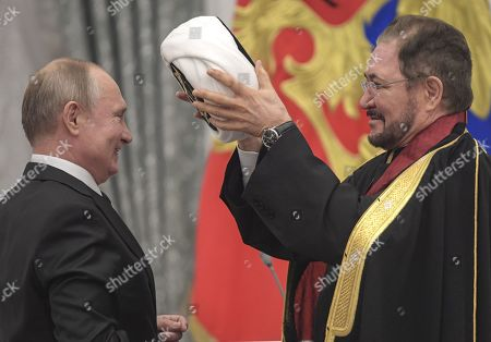 Stock Photo of Russian President Vladimir Putin presented orders and medals for outstanding achievements in culture, medicine, sports and production. Russian President Vladimir Putin (left) and Chairman of the Religious Board of Muslims of Russia Ravil Gainutdin (right) during the ceremony.