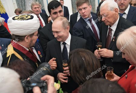 Russian President Vladimir Putin presented orders and medals for outstanding achievements in culture, medicine, sports and production. Chairman of the Russian Mufties Council, Chairman of the Religious Board of Muslims of Russia Ravil Gainutdin (left), Russian President Vladimir Putin (center) and Chairman of the State Council of the Republic of Dagestan Magomedali Magomedov (right) during the ceremony.