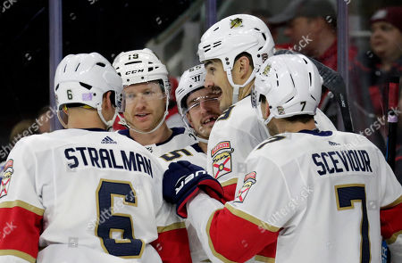 Florida Panthers' Brian Boyle (9), second from right, celebrates his goal with his teammates during the first period of an NHL hockey game against the Carolina Hurricanes in Raleigh, N.C