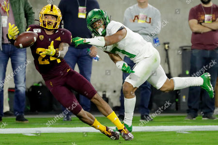 Arizona State defensive back Chase Lucas (24) can't make the catch intended for Oregon wide receiver Johnny Johnson III during the second half of an NCAA college football game, in Tempe, Ariz. Arizona State won 31-28