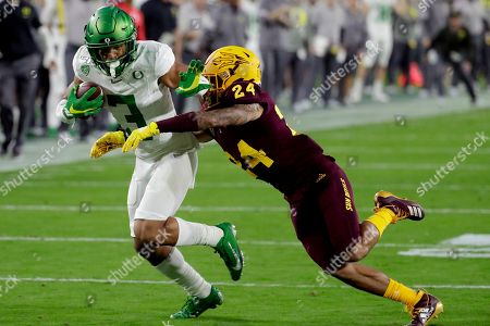 Oregon wide receiver Johnny Johnson III (3) runs with a reception as Arizona State defensive back Chase Lucas (24) defends during the first half of an NCAA college football game, in Tempe, Ariz