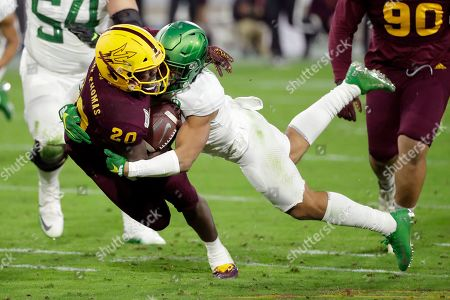 Arizona State linebacker Khaylan Kearse-Thomas (20) is tackled by Oregon wide receiver Johnny Johnson III after an interception during the second half of an NCAA college football game, in Tempe, Ariz. Arizona State won 31-28