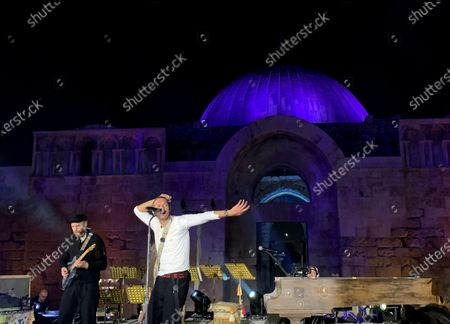 Stock Image of British frontman Chris Martin (R) and guitarist Jonny Buckland (L) of the band Coldplay perform during a concert at the Citadel in Amman, Jordan, 23 November 2019. Coldplay launched their new album, called Everyday Life, on 22 November via live streaming from Jordan. The band performed on 23 November in Amman, in one of the two only concerts planned for the new album. The second concert is due to take place in London.