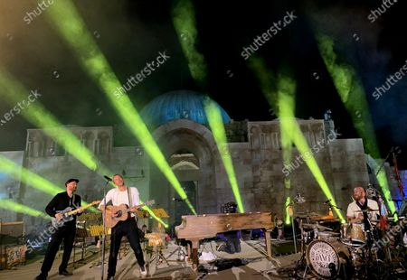 British frontman Chris Martin (C), drummer Will Champion (R) and guitarist Jonny Buckland (L) of the band Coldplay perform during a concert at the Citadel in Amman, Jordan, 23 November 2019. Coldplay launched their new album, called Everyday Life, on 22 November via live streaming from Jordan. The band performed on 23 November in Amman, in one of the two only concerts planned for the new album. The second concert is due to take place in London.
