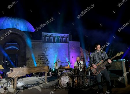 Stock Image of British drummer Will Champion (L) and bassist Guy Berryman (R) of the band Coldplay perform during a concert at the Citadel in Amman, Jordan 23 November 2019. Coldplay launched their new album, called Everyday Life, on 22 November via live streaming from Jordan. The band performed on 23 November in Amman, in one of the two only concerts planned for the new album. The second concert is due to take place in London.