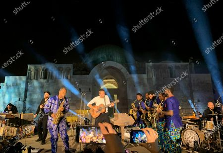 British front man Chris Martin of the band Coldplay (C) and Nigerian musician Femi Kuti (2-L) perform during a concert at the Citadel in Amman, Jordan, 23 November 2019. Coldplay launched their new album, called Everyday Life, on 22 November via live streaming from Jordan. The band performed on 23 November in Amman, in one of the two only concerts planned for the new album. The second concert is due to take place in London.