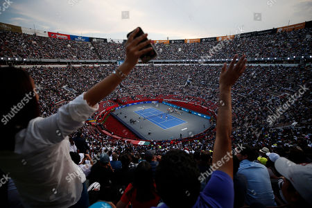 Spectators wave from the stands as brothers Bob and Mike Bryan of the U.S., left, take on Mexico's Miguel Angel Reyes Varela and Santiago Gonzalez in an exhibition doubles tennis match in the Plaza de Toros bullring in Mexico City, . Roger Federer of Switzerland and Germany's Alexander Zverev were also to face off in the converted bullring Saturday, the fourth stop in a tour of Latin America by the tennis greats