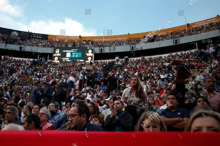 Spectators look on during an exhibition doubles tennis match between brothers Bob and Mike Bryan of the U.S. and Mexico's Miguel Angel Reyes Varela and Santiago Gonzalez in match in the Plaza de Toros bullring in Mexico City, . Roger Federer of Switzerland and Germany's Alexander Zverev were also to face off in the converted bullring Saturday, the fourth stop in a tour of Latin America by the tennis greats