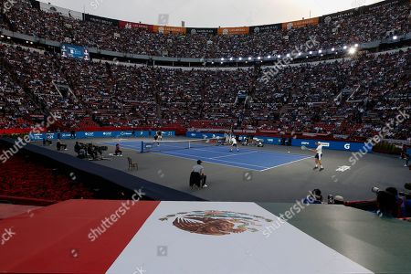 Brothers Bob and Mike Bryan of the U.S., right, take on Mexico's Miguel Angel Reyes Varela and Santiago Gonzalez in an exhibition doubles tennis match in the Plaza de Toros bullring in Mexico City, . Roger Federer of Switzerland and Germany's Alexander Zverev were also to face off in the converted bullring Saturday, the fourth stop in a tour of Latin America by the tennis greats