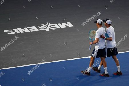 Twins Bob, left, and Mike Bryan of the U.S. walk off the court during an exhibition doubles tennis match against Mexico's Miguel Angel Reyes Varela and Santiago Gonzalez in the Plaza de Toros bullring in Mexico City, . The Bryan brothers announced earlier this month that they will retire after the 2020 U.S. Open, closing a professional tennis partnership that includes a men's doubles record of 16 Grand Slam championships
