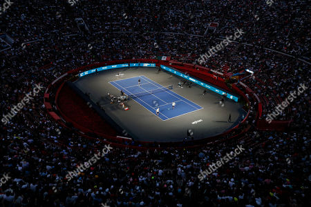 Stock Image of Brothers Bob and Mike Bryan of the U.S., right, take on Mexico's Miguel Angel Reyes Varela and Santiago Gonzalez in an exhibition doubles tennis match in the Plaza de Toros bullring in Mexico City, . Roger Federer of Switzerland and Germany's Alexander Zverev were also to face off in the converted bullring Saturday, the fourth stop in a tour of Latin America by the tennis greats