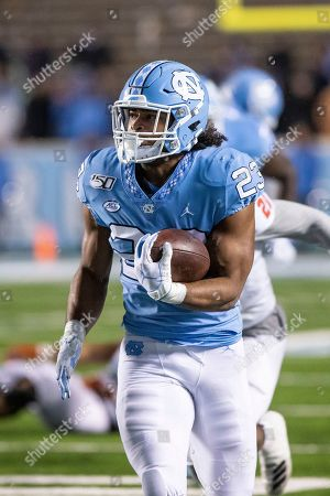 Stock Photo of North Carolina's Josh Henderson (23) carries the ball during an NCAA college football game against Mercer in Durham, N.C