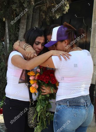 Teresa, from left, Maria and Thalia Carreno embrace during a ceremony in remembrance of their sister Briseida who was killed a year ago, in Ecatepec, a suburb of Mexico City, . Ecatepec is ground zero in the country for gender-related killings of women known as feminicides. On average, 10 women are murdered each day in Mexico, making it one of the most dangerous places in the world to be female