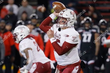 Temple quarterback Anthony Russo (15) passes during the first half of an NCAA college football game against Cincinnati, in Cincinnati
