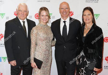 Stock Photo of Doug Messier, Kim Clark, Mark Messier and Mark-Kay Messier