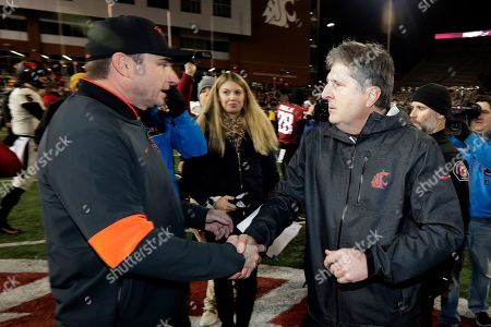 Washington State head coach Mike Leach, right, shakes hands with Oregon State head coach Jonathan Smith, left, after an NCAA college football game, in Pullman, Wash. Washington State won 54-53