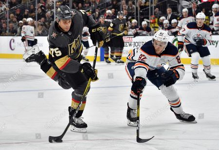 Vegas Golden Knights right wing Ryan Reaves (75) shoots next to Edmonton Oilers defenseman Caleb Jones during the second period of an NHL hockey game, in Las Vegas