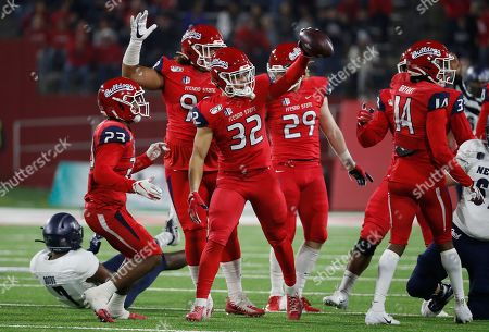 Fresno State defensive back Evan Williams holds up the ball after a fumble by Nevada during the first half of an NCAA college football game in Fresno, Calif