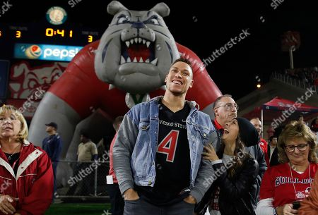 New York Yankee Aaron Judge, a former Fresno State baseball player, and his girlfriend, Samantha Bracksieck, watch the first half of an NCAA college football game between Nevada and Fresno State in Fresno, Calif