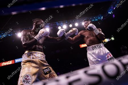 Deontay Wilder of the US (L) in action against Luis Ortiz II (R) of Cuba during a World Boxing Council World Heavyweight Championship fight at the MGM Grand Garden Arena in Las Vegas, Nevada, USA, 23 November 2019.