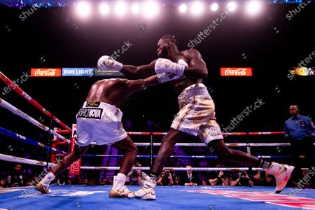 Deontay Wilder of the USA (R) in action against Luis Ortiz II (L) of Cuba during a World Boxing Council World Heavyweight Championship fight at the MGM Grand Garden Arena in Las Vegas, Nevada, USA, 23 November 2019.