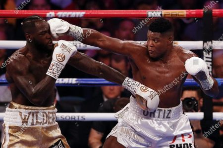 Deontay Wilder of the US (L) in action against Luis Ortiz II of Cuba during their WBC World Heavyweight Championship fight at the MGM Grand Garden Arena in Las Vegas, Nevada, USA, 23 November 2019.