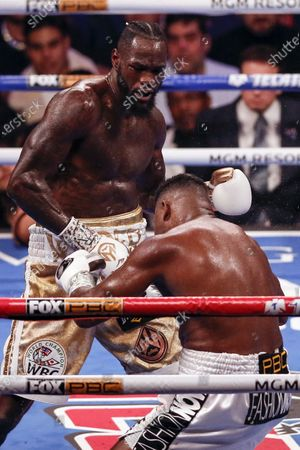 Deontay Wilder of the US (L) knocks out Luis Ortiz II of Cuba during their WBC World Heavyweight Championship fight at the MGM Grand Garden Arena in Las Vegas, Nevada, USA, 23 November 2019.