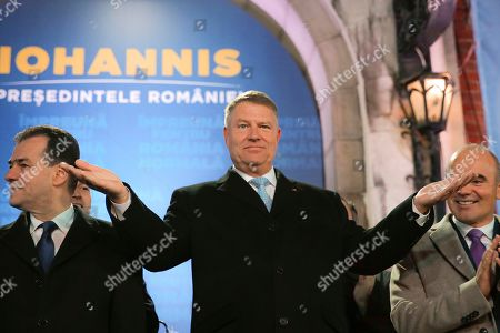 Romanian President Klaus Iohannis gestures after exit polls were published, in Bucharest, Romania, . An exit poll by the IRES independent think tank indicates Iohannis getting 66.5 % of the votes, with 33.5% for Social Democratic Party leader Viorica Dancila, a former prime minister