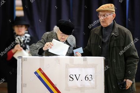 People vote in Bucharest, Romania, . Romanians are voting in a presidential runoff election in which incumbent Klaus Iohannis is vying for a second term, facing Social Democratic Party leader Viorica Dancila, a former prime minister, in Sunday's vote
