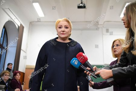 Former Prime Minister and presidential candidate for the Social Democratic party Viorica Dancila prepares to speak to the media after casting her vote in Bucharest, Romania, . Romanians are voting in a presidential runoff election in which incumbent Klaus Iohannis is vying for a second term