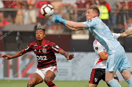 Stock Photo of River Plate's player Bruno Henrique (L) and goalkeeper Franco Armani (R) of River Plate in action during the Copa Libertadores 2019 final soccer match between Flamengo and River Plate, at Monumental stadium in Lima, Peru, 23 November 2019.