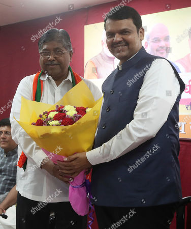 Devendra Fadnavis, Chandrakant Patil. Chief Minister of Maharashtra state Devendra Fadnavis, right, is presented a flower bouquet by Chandrakant Patil, President of Maharashtra at the Bhartiya Janata Party (BJP) office in Mumbai, India, . Fadnavis was sworn in as the chief minister on Saturday morning