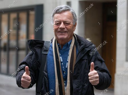 Stock Image of Tony Blackburn, legendary DJ, gives thumbs up as he arrives at the BBC Studios.