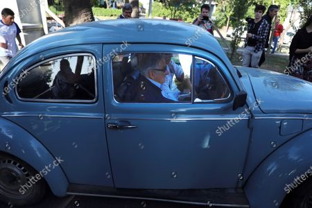 Uruguayan former president Jose Mujica arrives in his Beetle to cast his vote at a polling station in Montevideo, Uruguay, 24 November 2019. Uruguay holds the second round of the presidential elections.