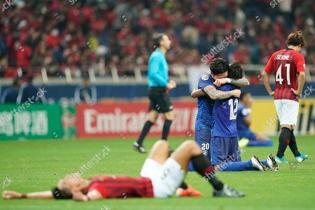 Japan AFC Soccer - Urawa Reds vs Al Hilal. Al Hilal's Jang Hyun-Soo, left, and Al Hilal's Yaseer Al-Shahrani, right, hug after winning the second leg of the AFC Champions League final soccer match against Urawa Reds in Saitama, near Tokyo