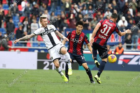 Bologna's Blerim Dzemaili (L) and Parma's Juraj Kucka (L) in action during the Italian Serie A soccer match  Bologna FC vs Parma Calcio at Renato Dall'Ara stadium in Bologna, Italy, 24 November 2019.
