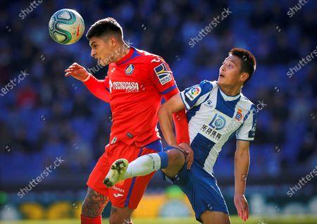 Getafe FC's Brazilian midfielder Robert Kenedy Nunes do Nascimento (L) fights for the ball Chinese striker Wu Lei (R) of RCD Espanyol during their LaLiga match between Getafe FC and RCD Espanyol played at Cornella stadium in Barcelona, Catalonia on 24 November 2019.