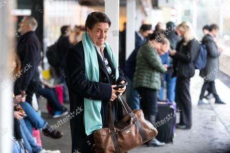 Nick Griffin - Former President and Chairman of the far-right 'British National Party' - waits for a train.