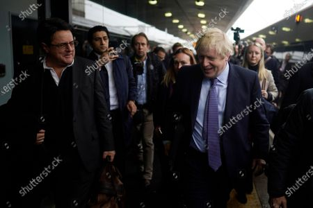 Stock Picture of British Prime Minister Boris Johnson (R) departs a train and on his way to announce the Conservative party manifesto and passes former leader of the British National Party (BNP) Nick Griffin (L), in Wolverhampton, West Midlands, Britain, 24 November 2019. Britons will go to the polls in a general election on 12 December.
