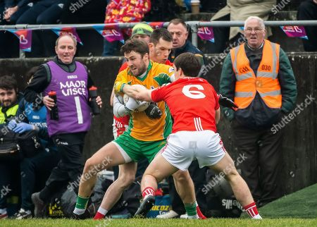 Stock Image of Corofin (Galway) vs Padraig Pearses (Roscommon). Corofin's Michael Lundy with Padraig Pearses David Murray and Niall Carty