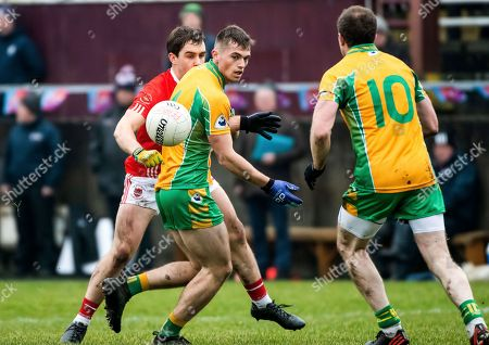 Corofin (Galway) vs Padraig Pearses (Roscommon). Corofin's Liam Silke and Padraig Pearses David Murray