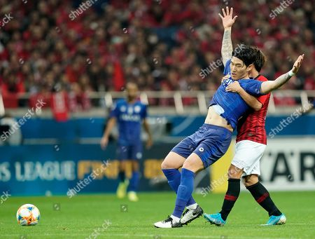 Al Hilal's Jang Hyun-Soo, left, is held by Urawa Reds' Takahiro Sekine, during the second leg of the AFC Champions League final soccer match between Urawa Reds and Al Hilal in Saitama, near Tokyo