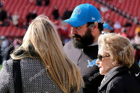 Detroit Lions head coach Matt Patricia, center, stands next to team owner Martha Firestone Ford, right, prior to an NFL football game against the Washington Redskins, in Landover, Md