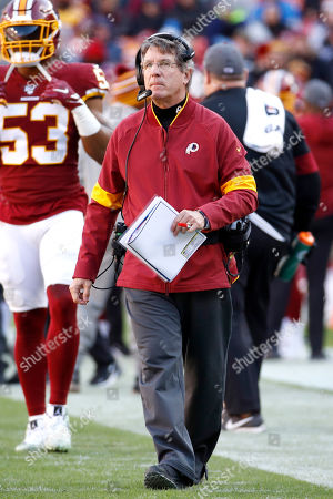 Washington Redskins head coach Bill Callahan looks on during the first half of an NFL football game against the Detroit Lions, in Landover, Md