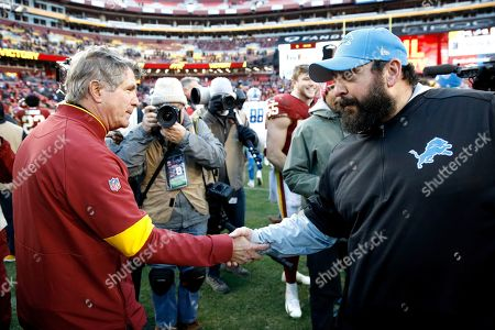 Washington Redskins head coach Bill Callahan, left, shakes hands with Detroit Lions head coach Matt Patricia after an NFL football game, in Landover, Md. The Redskins won 19-16